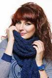 Woman with knitted wool scarf Stock Image