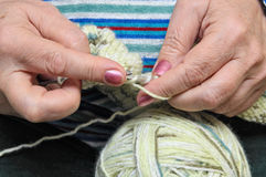 Woman Knitting. An unrecognizable woman knitting. Closeup of knitting woman's hands Stock Image
