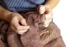 Woman knitting Stock Photography