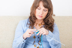 Woman knitting Stock Photography