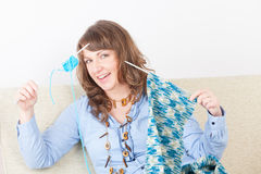Woman knitting. Beautiful woman sitting with knitting woll and needles Royalty Free Stock Photography