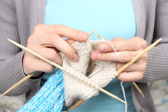 Woman knitting blue socks closeup Royalty Free Stock Photography