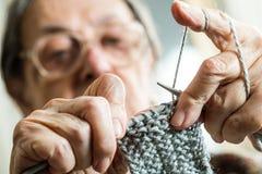 Woman knitting stock photo