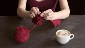 Woman with knitting and coffee stock video footage