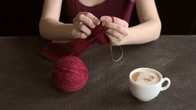 Woman with knitting and coffee stock footage