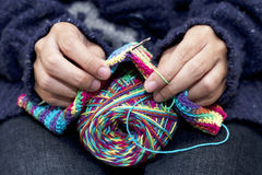 Woman knitting with collorful wool. Stock Photo