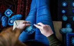 Woman Knitting / crocheting granny squares. Close up shot of a woman Knitting granny squares Royalty Free Stock Photo