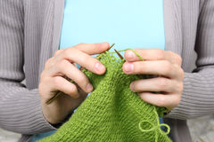 Woman knitting green woolen threads closeup Royalty Free Stock Photo