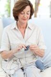 Woman knitting at home Royalty Free Stock Photos