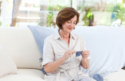Woman knitting at home Royalty Free Stock Images