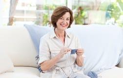 Woman knitting at home Stock Photo