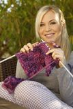 Woman knitting outdoor Royalty Free Stock Photo