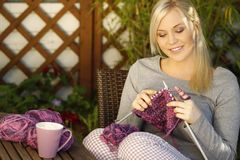 Woman knitting outdoor. Woman knitting on the terrace Stock Photography
