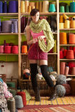 Woman Knitting Scarf Standing In Front Of Yarn Stock Images