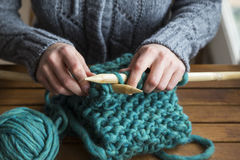 Woman knitting scarf Royalty Free Stock Photo