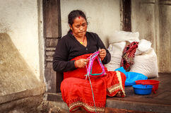 A woman is knitting souvenirs in Bhaktapur,Nepal Stock Image