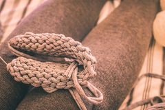 Woman knitting. Socks at home. Yarn on female legs stock image