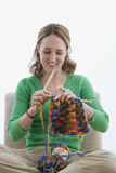 Woman Knitting with Yarn - Isolated Stock Image