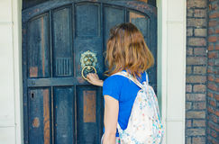 Woman knocking on door Stock Photo