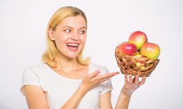 Woman know how stay in shape and be healthy. Take advantage of this fall produce and bite into juicy apple. Girl hold. Basket apples white background royalty free stock photos