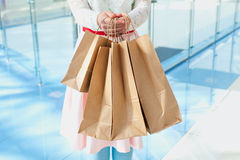 Woman with kraft bags in store Royalty Free Stock Images