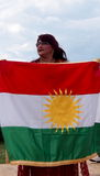Woman And Kurdistan Flag At Edmonton Heritage Days 2013 Royalty Free Stock Photo