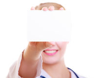 Woman in lab coat. Doctor or nurse with blank card isolated Stock Photos