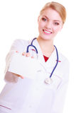 Woman in lab coat. Doctor or nurse with blank card isolated Royalty Free Stock Photos