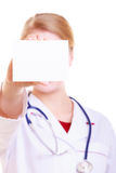 Woman in lab coat. Doctor or nurse with blank card isolated Stock Photo