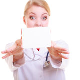 Woman in lab coat. Doctor or nurse with blank card isolated Royalty Free Stock Photography