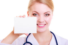 Woman in lab coat. Doctor or nurse with blank card isolated Royalty Free Stock Image