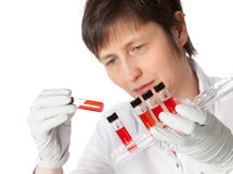Woman in lab coat with  liquid samples. Stock Photos