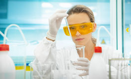 Woman in lab with equipments, pipettes Royalty Free Stock Photography