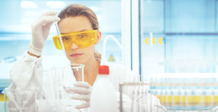 Woman in lab with equipments, pipettes Royalty Free Stock Image