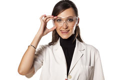 Woman lab technician. Smiling woman lab technician holds her goggles Stock Photo