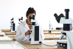 Woman in laboratory Stock Images