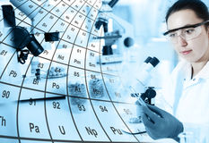 Woman laboratory assistant in the laboratory Royalty Free Stock Images