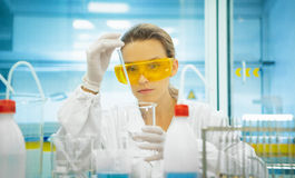 Woman in laboratory with pipettes, researcher Royalty Free Stock Image