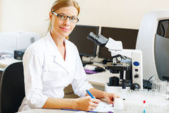 Woman in a laboratory working Royalty Free Stock Photo