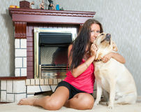 Woman with  Labrador retriever in home Royalty Free Stock Image
