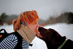 Woman and Labrador Share a Cookie Royalty Free Stock Images