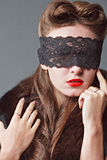 Woman with a lace blindfold. Royalty Free Stock Images