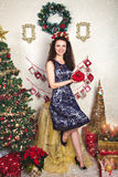 Woman in lace dress among Christmas decoration Stock Photography