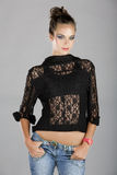 Woman in lace jacket and jeans Stock Photos