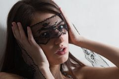 Woman with lace mask Stock Image