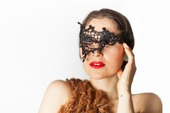 Woman with lace mask. Woman wearing a lace mask stock images