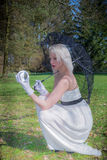Woman with lace umbrella and glass ball Stock Image