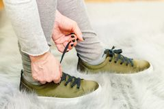 Woman lace up sneakers Stock Photos