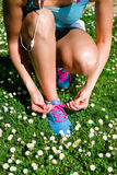 Woman lacing running shoes in spring Stock Images