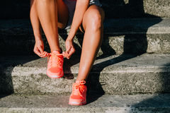 Woman lacing running shoes before workout Stock Images